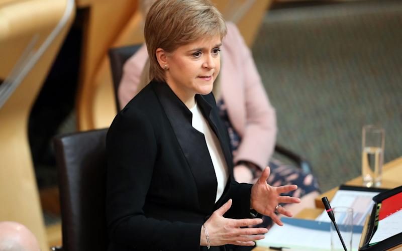 First Minister Nicola Sturgeon during First Minister's Questions at the Scottish Parliament  - Credit: PA