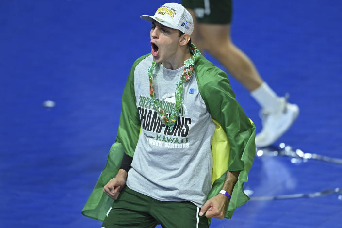 Hawaii's Guilherme Voss celebrates after Hawaii defeated BYU in the final of the NCAA men's volleyball tournament Saturday, May 8, 2021, in Columbus, Ohio. (AP Photo/David Dermer)