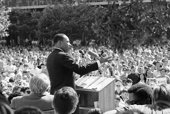 <p>A large portion of the estimated 5,000 who listened intently to Dr. Martin Luther King, arrow, lower right, from Sproul Hall, University of California administration building in Berkeley, Calif., May 17, 1967. (AP Photo) </p>