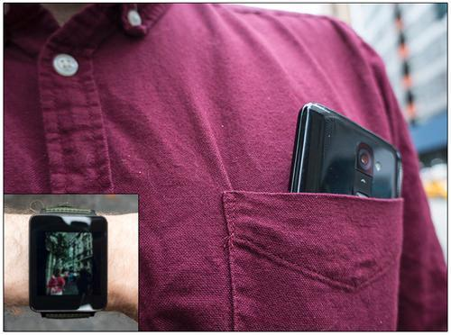 Smartphone camera protruding from shirt pocket