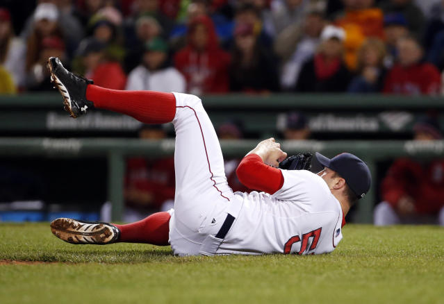 Boston Red Sox relief pitcher Chris Capuano lands on his back as he avoids Atlanta Braves Jason Heyward's broken bat in the seventh inning of a baseball game at Fenway Park in Boston, Wednesday, May 28, 2014. (AP Photo/Elise Amendola)