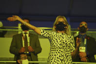 First lady of the United States Jill Biden waves during the opening ceremony in the Olympic Stadium at the 2020 Summer Olympics, Friday, July 23, 2021, in Tokyo, Japan. (Dylan Martinez/Pool Photo via AP)
