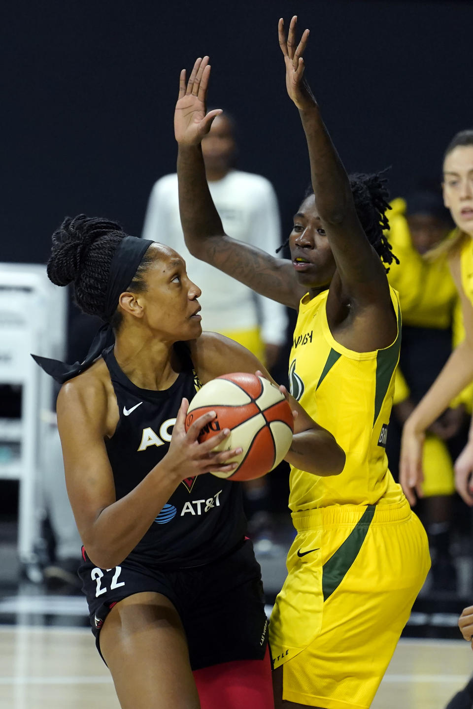 Las Vegas Aces center A'ja Wilson (22) goes up against Seattle Storm forward Natasha Howard (6) during the first half of Game 1 of basketball's WNBA Finals Friday, Oct. 2, 2020, in Bradenton, Fla. (AP Photo/Chris O'Meara)