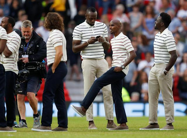 Soccer Football - Soccer Aid 2018 - England v Soccer Aid World XI - Old Trafford, Manchester, Britain - June 10, 2018 Usain Bolt and Mo Farah before the match REUTERS/Phil Noble