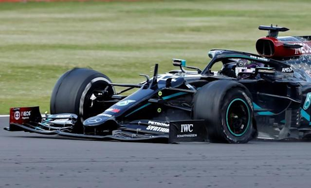 Three-wheeling: Lewis Hamilton limps home to a record seventh win at the British Grand Prix on Sunday (AFP Photo/ANDREW BOYERS)