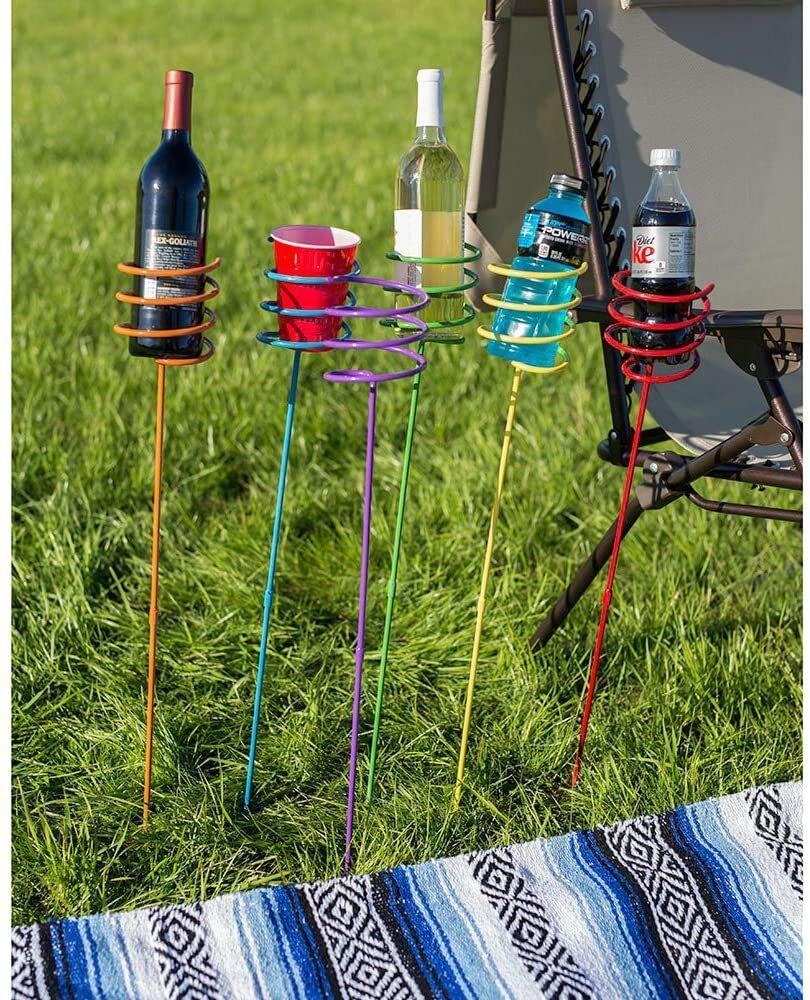 """This genius invention will hold your cold beverages, soda cans and vino and keep them off the ground. They're also the perfect height for a camping or patio chair.<br /><br /><strong>Promising review:</strong>""""One of the best items I have ever bought for the beach and backyard!<strong>Whether playing Cornhole or lounging in a chair, your drink is always clean and cold. No more sandy or dirty cans or bottles.</strong>It even holds your drink with a Koozie on it!"""" —<a href=""""https://amzn.to/3sNMOiZ"""" target=""""_blank"""" rel=""""nofollow noopener noreferrer"""" data-skimlinks-tracking=""""5580838"""" data-vars-affiliate=""""Amazon"""" data-vars-href=""""https://www.amazon.com/gp/customer-reviews/R28RU2FH13A8FR?tag=bfgenevieve-20&ascsubtag=5580838%2C14%2C33%2Cmobile_web%2C0%2C0%2C1159958"""" data-vars-keywords=""""cleaning"""" data-vars-link-id=""""1159958"""" data-vars-price="""""""" data-vars-product-id=""""16176859"""" data-vars-retailers=""""Amazon"""">Amazon Customer</a><br /><br /><strong>Get a set of six from Amazon for<a href=""""https://amzn.to/3sGGn1q"""" target=""""_blank"""" rel=""""nofollow noopener noreferrer"""" data-skimlinks-tracking=""""5580838"""" data-vars-affiliate=""""Amazon"""" data-vars-asin=""""B0168OB460"""" data-vars-href=""""https://www.amazon.com/dp/B0168OB460?tag=bfgenevieve-20&ascsubtag=5580838%2C14%2C33%2Cmobile_web%2C0%2C0%2C1159973"""" data-vars-keywords=""""cleaning"""" data-vars-link-id=""""1159973"""" data-vars-price="""""""" data-vars-product-id=""""1402849"""" data-vars-product-img=""""https://m.media-amazon.com/images/I/51xQiFLf7xL._SL500_.jpg"""" data-vars-product-title=""""Sunnydaze Outdoor Yard Drink Holder Stakes, Heavy Duty, Set of 6, Multi Colored"""" data-vars-retailers=""""Amazon"""">$37.95</a>.</strong>"""