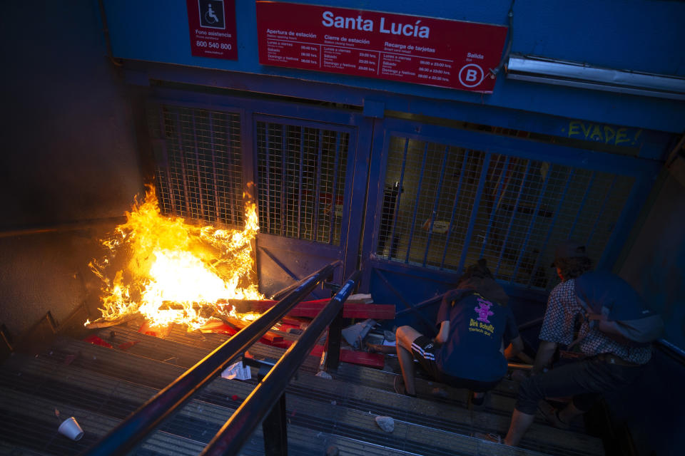 Protesters push a bicycle in front of a gate of the Santa Lucia subway station during a protest against the rising cost of subway and bus fares, in Santiago, Friday, Oct. 18, 2019. (Photo: Esteban Felix/AP)
