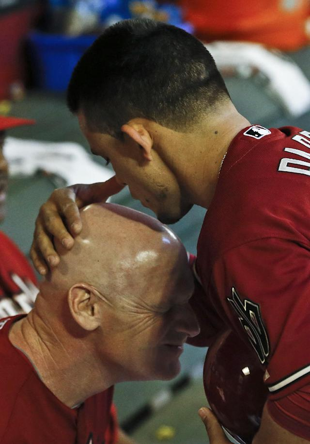 FILE - In this May 1, 2013 file photo, Arizona Diamondbacks' Gerardo Parra, right, kisses the head of third base coach Matt Williams in the dugout prior to a baseball game against the San Francisco Giants, in Phoenix. Williams is the new manager of the Washington Nationals. The Nationals will hold a news conference Friday, Nov. 1, 2013, to introduce Williams as the team's fifth manager since it moved to Washington from Montreal in 2005. He replaces Davey Johnson, who is retiring.(AP Photo/Ross D. Franklin, File)