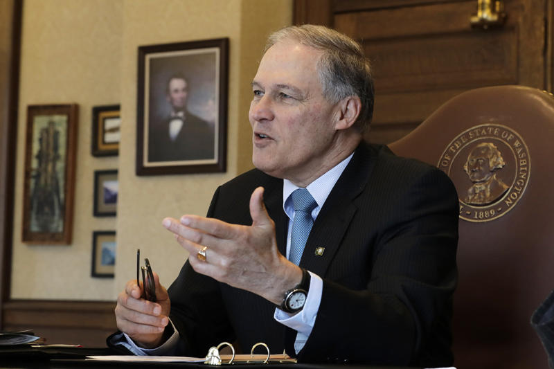 Washington Gov. Jay Inslee speaks during a morning meeting with staff members in his office, Wednesday, Feb. 27, 2019, at the Capitol in Olympia, Wash. (AP Photo/Ted S. Warren)