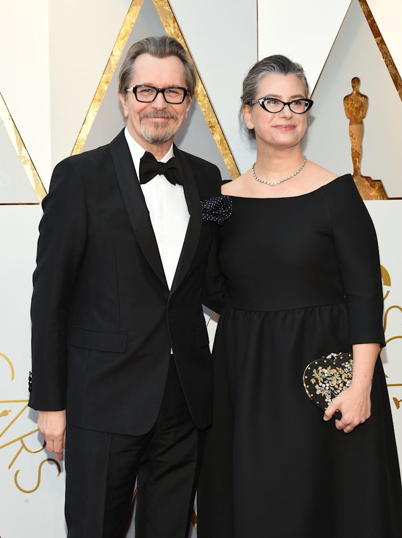 Gary Oldman and Gisele Schmidt arrive for the 90th Annual Academy Awards. (VALERIE MACON via Getty Images)