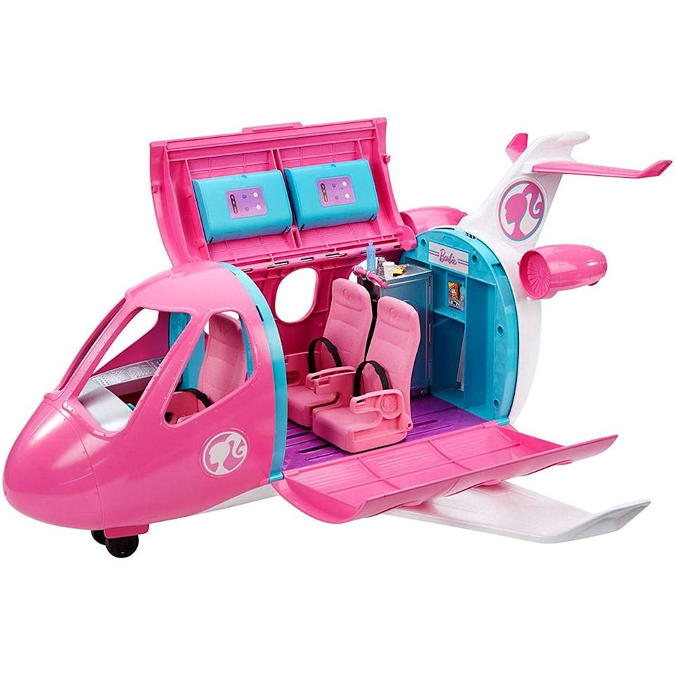 """<p><strong>Barbie</strong></p><p>amazon.com</p><p><strong>$59.00</strong></p><p><a href=""""https://www.amazon.com/dp/B07NC58H7P?tag=syn-yahoo-20&ascsubtag=%5Bartid%7C2089.g.97%5Bsrc%7Cyahoo-us"""" target=""""_blank"""">Shop Now</a></p><p>Since her inception, Barbie has had several careers, vacations, and roles in her plastic world. She is now jet-setting with her gal pals in the Barbie Dreamplane Playset. Your little aviator's imagination will take flight with the 15-piece set, which includes doors that open and a tiny pup travel friend. </p>"""