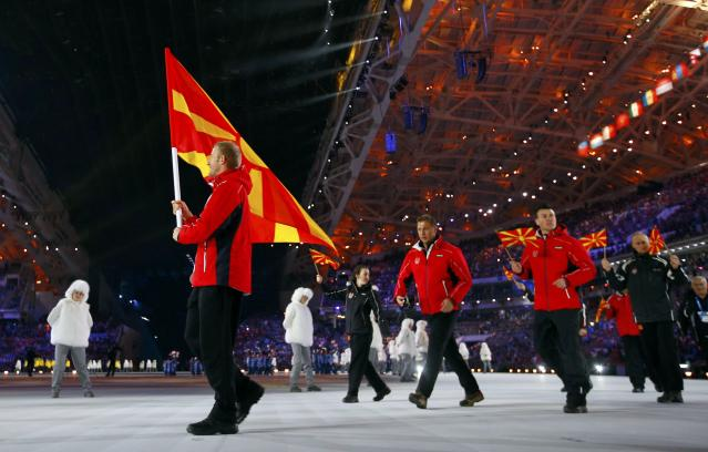 Macedonia's flag-bearer Darko Damjanovski leads his country's contingent during the opening ceremony of the 2014 Sochi Winter Olympic Games February 7, 2014. REUTERS/Brian Snyder (RUSSIA - Tags: SPORT OLYMPICS)
