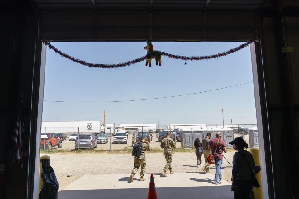 A piñata hangs in a building at Fort Bliss' Doña Ana Village, in New Mexico, which previously used to hold migrant children in 2016 but now houses Afghan refugees, Friday, Sept. 10, 2021. The Biden administration provided the first public look inside the U.S. military base where Afghans airlifted out of Afghanistan are screened, amid questions about how the government is caring for the refugees and vetting them. (AP Photo/David Goldman)