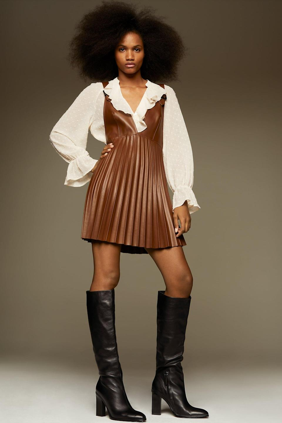 <p>This <span>Faux Leather Pinafore Skirt</span> ($50) looks chic with knee-high boots.</p>