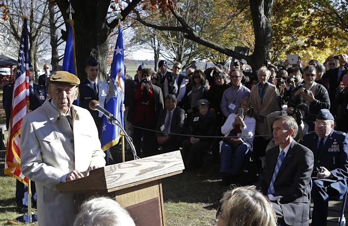 Richard Cole, left, one of the four surviving members of the 1942 raid on Tokyo led by Lt. Col. Jimmy Doolittle, speaks for the other survivors during ceremonies honoring them, Saturday, Nov. 9, 2013, at the National Museum of the US Air Force in Dayton, Ohio. (AP Photo/Al Behrman)