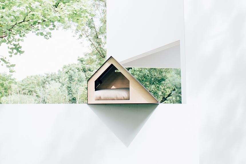 "Another new release from Pets So Good is this modern doghouse made of plywood and steel. Called <a href=""https://petssogood.com/collections/bad/products/deauville-coming-soon"" rel=""nofollow"">Deauville</a>, the minimalist design has windows and light panels on the top and an antibacterial microfiber cushion inside. It'll keep your pup warm on cold days and cool during the heat."