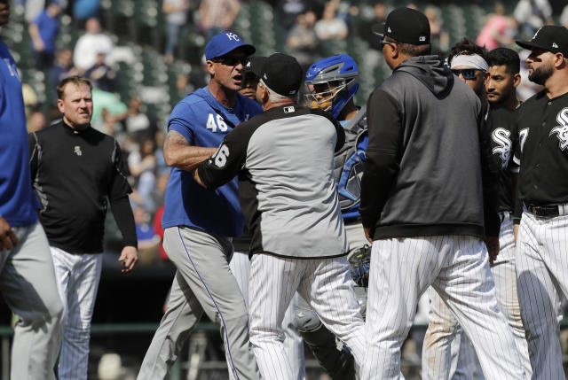 Kansas City Royals bench coach Dale Sveum (46) and Chicago White Sox manager Rick Renteria shove each other as benches clear after Chicago White Sox's Tim Anderson was hit by a pitch during the sixth inning of a baseball game in Chicago, Wednesday, April 17, 2019. The Royals won 4-3. (AP Photo/Nam Y. Huh)
