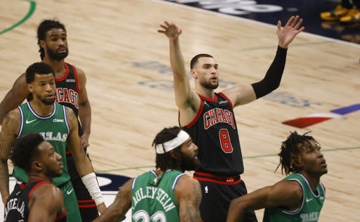 Chicago Bulls guard Zach LaVine (8) reacts after scoring on a free throw against the Dallas Mavericks during the first half of an NBA basketball game, Sunday, Jan. 17, 2021, in Dallas. (AP Photo/Ron Jenkins)