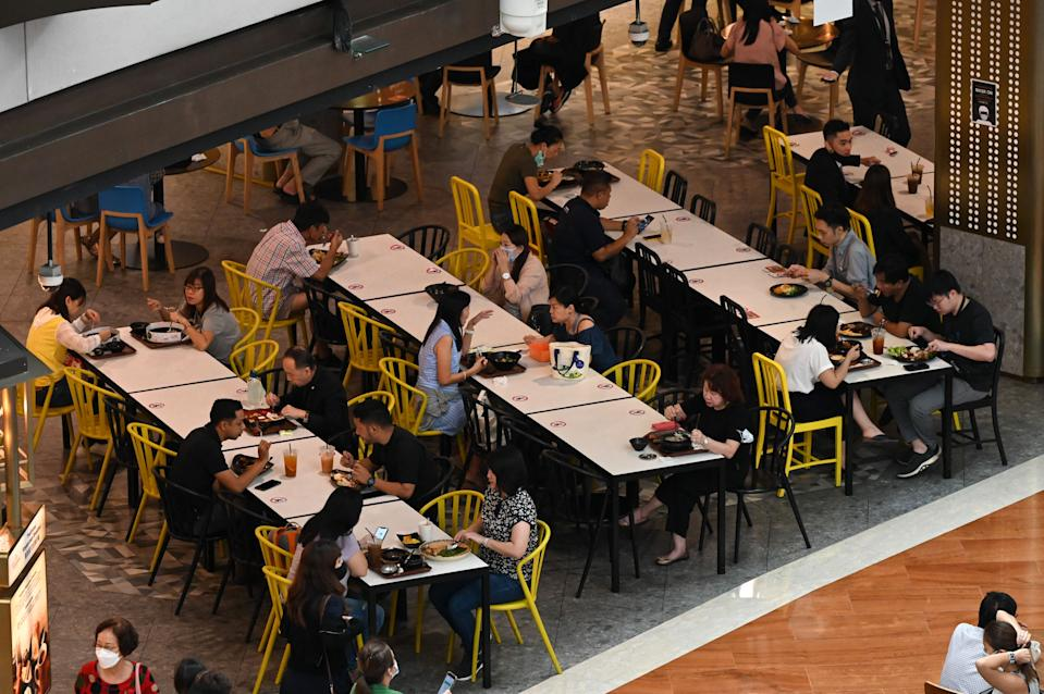 People dine at a restaurant in a shopping mall in Singapore on May 14, 2021, ahead of tightening restrictions over concerns of a rise in Covid-19 coronavirus cases. (Photo by Roslan Rahman / AFP) (Photo by ROSLAN RAHMAN/AFP via Getty Images)