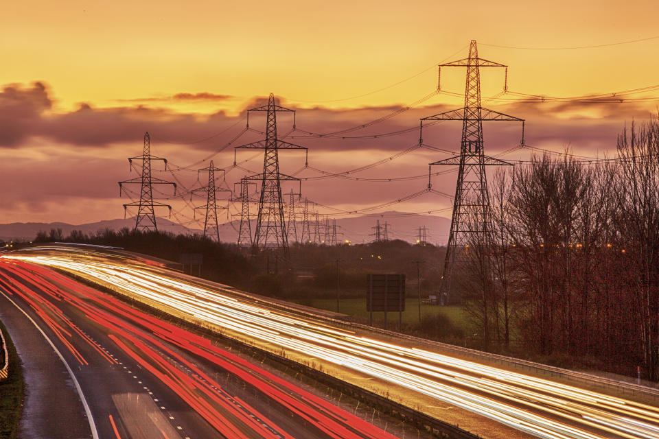 Rushhour on the M56 motorway near Helsby, Cheshire, UK at dusk.
