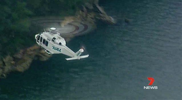 Rescue crews are trying to locate the submerged plane. Source: 7News