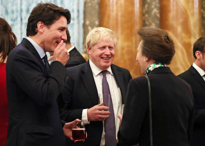 Canadian Prime Minister Justin Trudeau, British Prime Minister Boris Johnson and Princess Anne in conversation at Buckingham Palace.