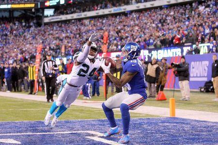 Dec 20, 2015; East Rutherford, NJ, USA; New York Giants wide receiver Odell Beckham Jr. (13) catches a touchdown pass in front of Carolina Panthers corner back Josh Norman (24) during the fourth quarter at MetLife Stadium. Mandatory Credit: Brad Penner-USA TODAY Sports