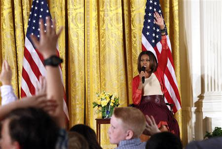 U.S. first lady Michelle Obama takes questions wile speaking with children of Executive Office employees at the White House's annual Take Our Daughters and Sons to Work Day in Washington