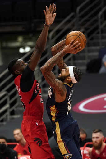 New Orleans Pelicans forward Brandon Ingram (14) shoots over Toronto Raptors forward Chris Boucher (25) during the second half of an NBA basketball game Wednesday, Dec. 23, 2020, in Tampa, Fla. (AP Photo/Chris O'Meara)