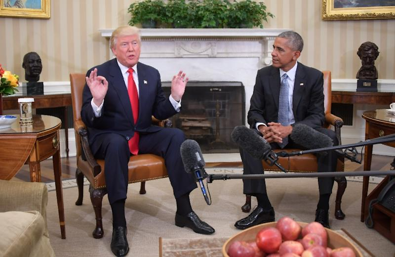US President Barack Obama meets with President-elect Donald Trump to update him on transition planning in the Oval Office at the White House on November 10, 2016 in Washington, DC (AFP Photo/Jim Watson)