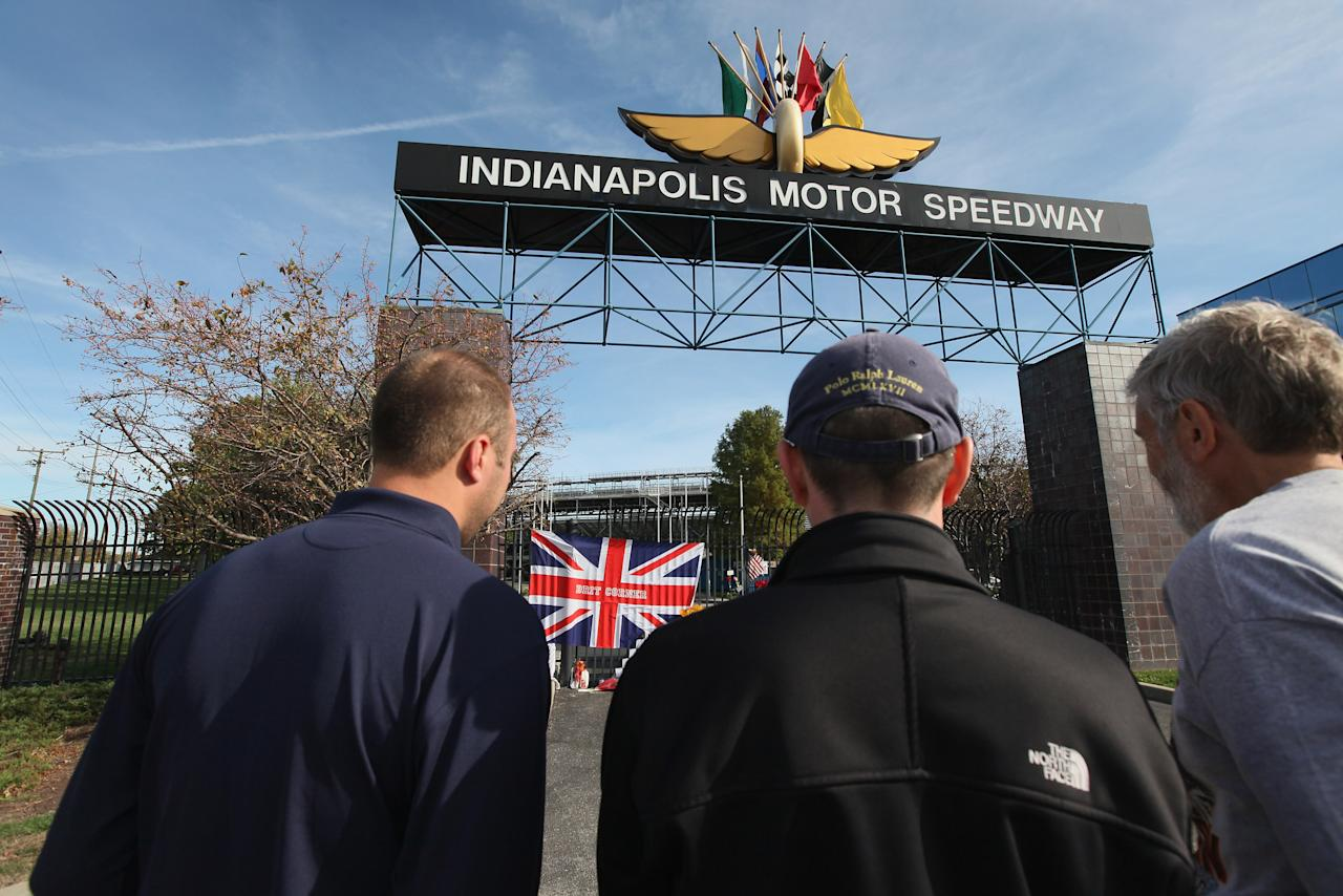 INDIANAPOLIS, IN - OCTOBER 17:  Fans look over a memorial to two-time Indianapolis 500 winner Dan Wheldon at the gate of the Indianapolis Motor Speedway on October 17, 2011 in Indianapolis, Indiana. Wheldon, winner of the 2011 Indy 500, was killed in a crash yesterday at the Izod IndyCar series season finale at Las Vegas Motor Speedway.  (Photo by Scott Olson/Getty Images)