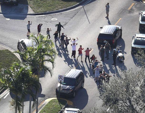 PHOTO: People are brought out of the Marjory Stoneman Douglas High School after a shooting at the school that killed and injured multiple people, Feb. 14, 2018, in Parkland, Fla. (Joe Raedle/Getty Images)