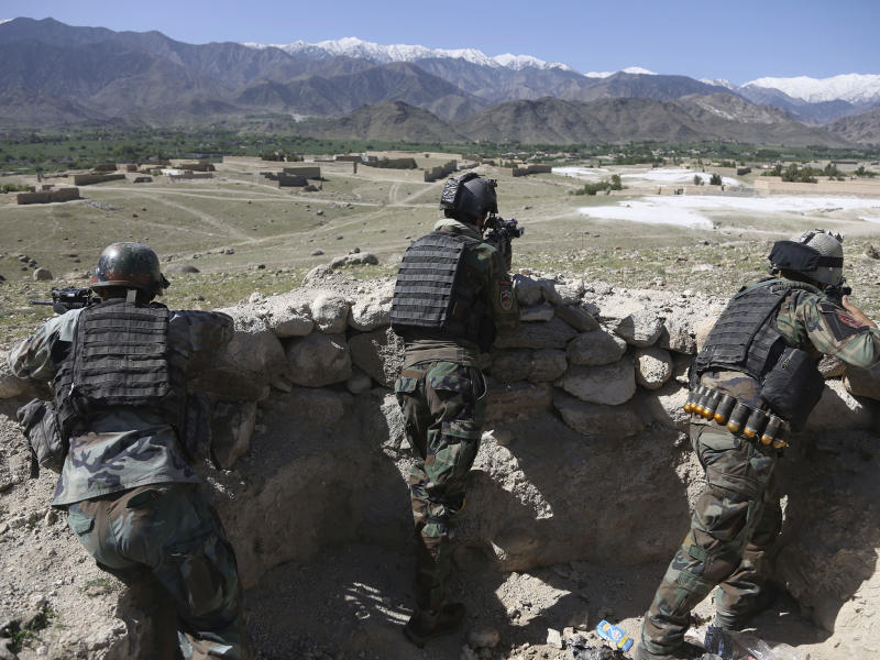 Afghan commandos are positioned in Pandola village, near the site of the US bomb drop: AP