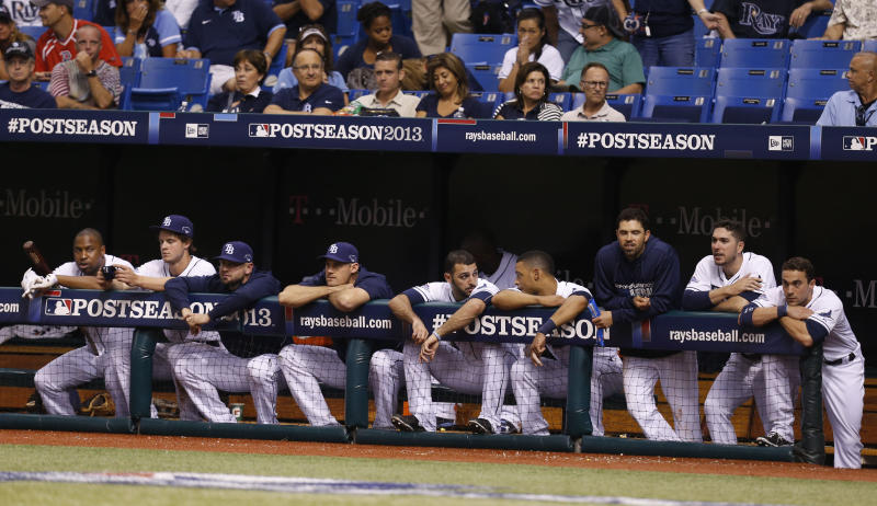The Tampa Bay Rays look out during the ninth inning in Game 4 of an American League baseball division series against the Boston Red Sox, Wednesday, Oct. 9, 2013, in St. Petersburg, Fla. The Boston Red Sox's defeated the Tampa Bay Rays 3-1 to move on to the American League Championship Series. (AP Photo/Mike Carlson)