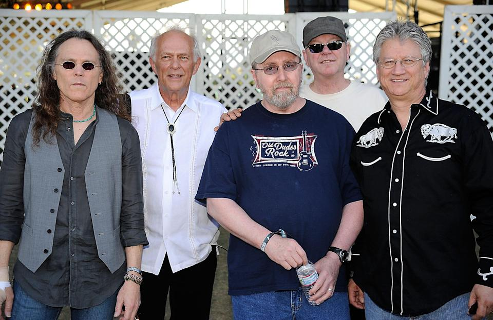 (L-R) Timothy B. Schmit, Paul Cotton, George Grantham, Rusty Young and Richie Furay pose backstage during day two of California's Stagecoach Country Music Festival held at the Empire Polo Club on April 26, 2009 in Indio, California.
