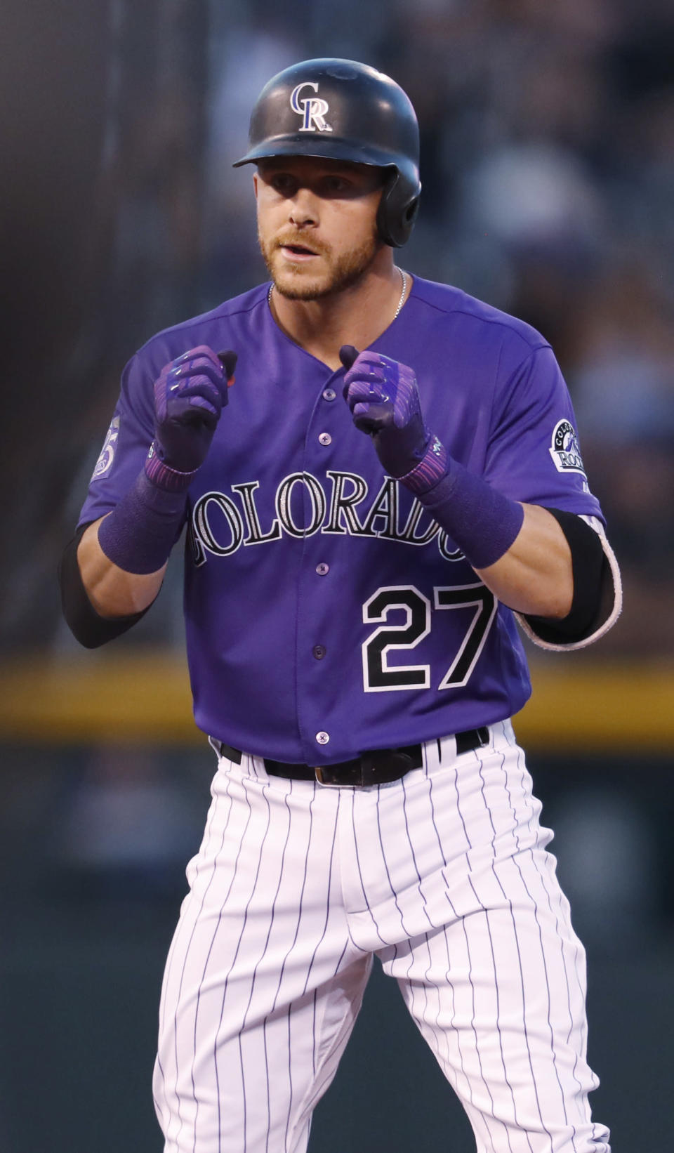 Colorado Rockies' Trevor Story reacts after his RBI-double off Arizona Diamondbacks starting pitcher Zack Greinke in the first inning of a baseball game Tuesday, Sept. 11, 2018, in Denver. (AP Photo/David Zalubowski)