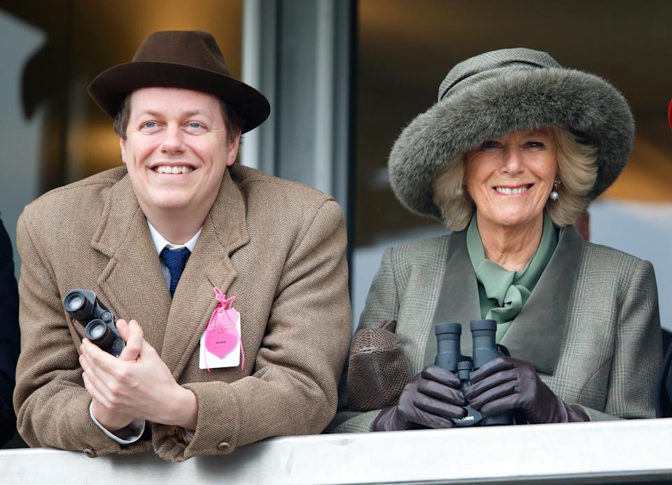 CHELTENHAM, UNITED KINGDOM - MARCH 11: (EMBARGOED FOR PUBLICATION IN UK NEWSPAPERS UNTIL 48 HOURS AFTER CREATE DATE AND TIME) Camilla, Duchess of Cornwall (right) and her son Tom Parker Bowles watch the racing as they attend day 2 of the Cheltenham Festival at Cheltenham Racecourse on March 11, 2015 in Cheltenham, England. (Photo by Max Mumby/Indigo/Getty Images)