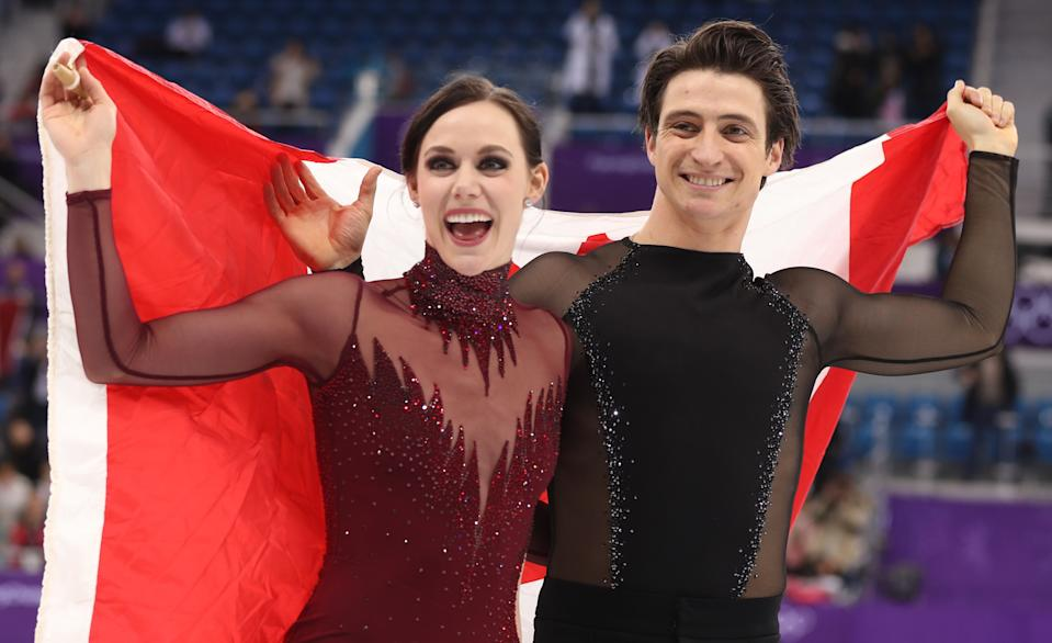 Figure Skating - Pyeongchang 2018 Winter Olympics - Ice Dance free dance competition final - Gangneung, South Korea - February 20, 2018 - Gold medallists Tessa Virtue and Scott Moir of Canada celebrate. REUTERS/Lucy Nicholson