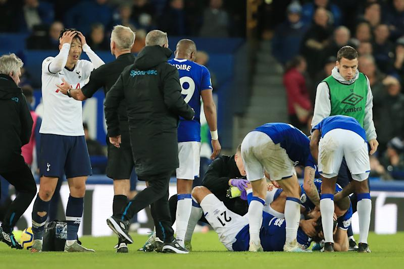 LIVERPOOL, ENGLAND - NOVEMBER 03: Son Heung-Min of Spurs (L) looks inconconsolable as Andre Gomes of Everton lies injured during the Premier League match between Everton FC and Tottenham Hotspur at Goodison Park on November 3, 2019 in Liverpool, United Kingdom. (Photo by Simon Stacpoole/Offside/Offside via Getty Images)