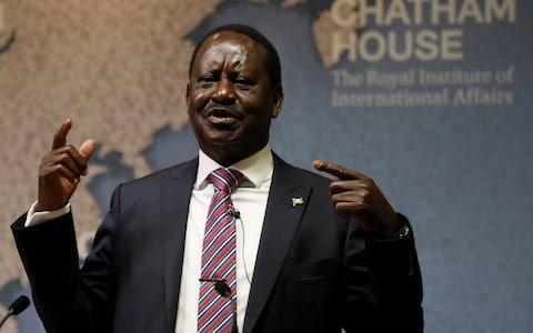 <span>Kenya's opposition party leader, Raila Odinga, speaking at Chatham House in London on October 13</span> <span>Credit: REUTERS </span>