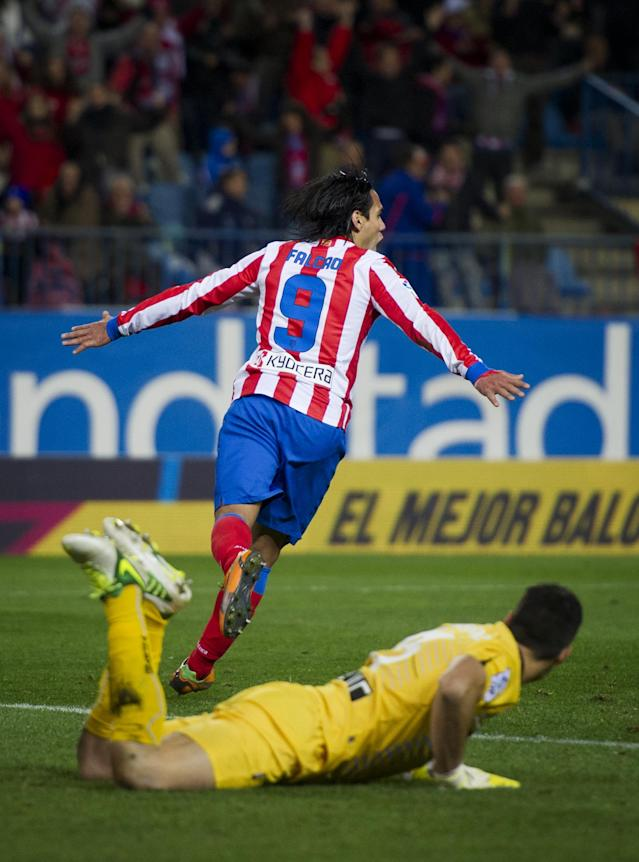 MADRID, SPAIN - OCTOBER 28: Falcao of Club Atletico de Madrid celebrates scoring leaving goalkeeper Andres Fernandez of Osasuna laying on the pitch behind during the La Liga match between Club Atletico de Madrid and CA Osasuna at the Vicente Calderon Stadium on October 28, 2012 in Madrid, Spain. (Photo by Jasper Juinen/Getty Images)