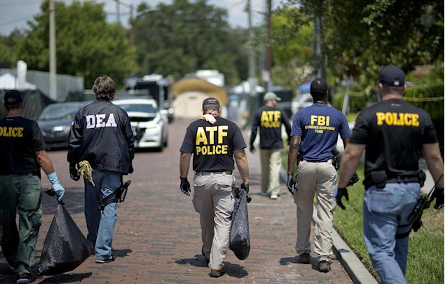 <p>Federal and local law enforcement officials walk through the street next to the scene of a mass shooting at a nightclub on June 13, 2016, in Orlando, Fla. (AP Photo/David Goldman) </p>