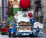 The characters Santa Claus and Mrs. Claus are helped from their float at the end of the modified Macy's Thanksgiving Day Parade in New York, Thursday, Nov. 26, 2020. Due to the pandemic, crowds of onlookers were not allowed to attend the annual parade. (AP Photo/Craig Ruttle)