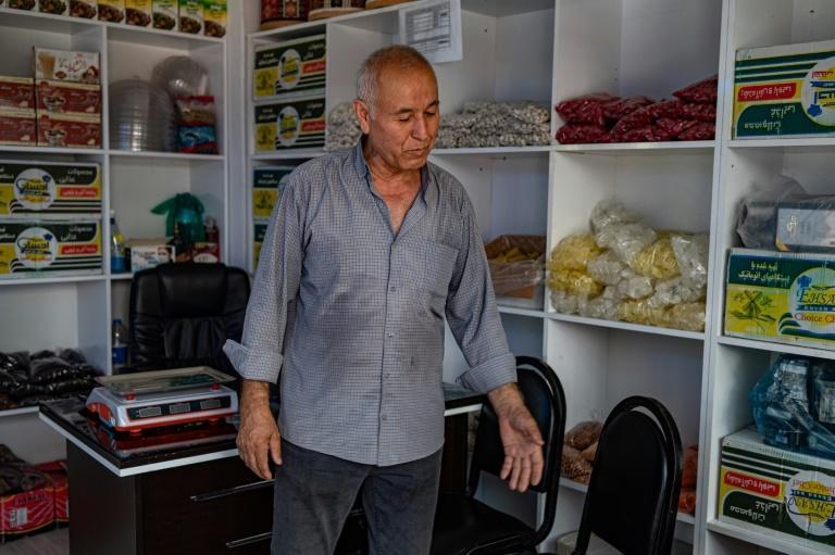 Convenience store owner Habib Uzbek, 69, received Turkish citizenship in 1993 but says he still feels pressure from being an Afghan (AFP/Yasin AKGUL)