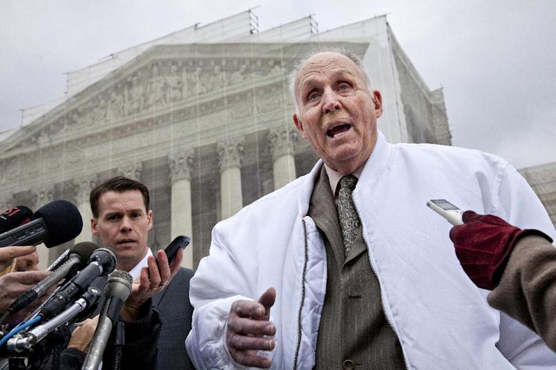 Vernon Hugh Bowman, a 75-year-old Indiana soybean farmer, accompanied by his attorney Mark Walters, speaks with reporters outside the Supreme Court in Washington, Tuesday, Feb. 19, 2013, after justices heard oral arguments between Bowman and high-tech agriculture company Monsanto Co. that produces genetically engineered and patented seeds. The case considers whether Bowman violated Monsanto's patents when he planted an unmarked mix of soybeans that he bought from a grain elevator and that is often used for feed.  (AP Photo/J. Scott Applewhite)