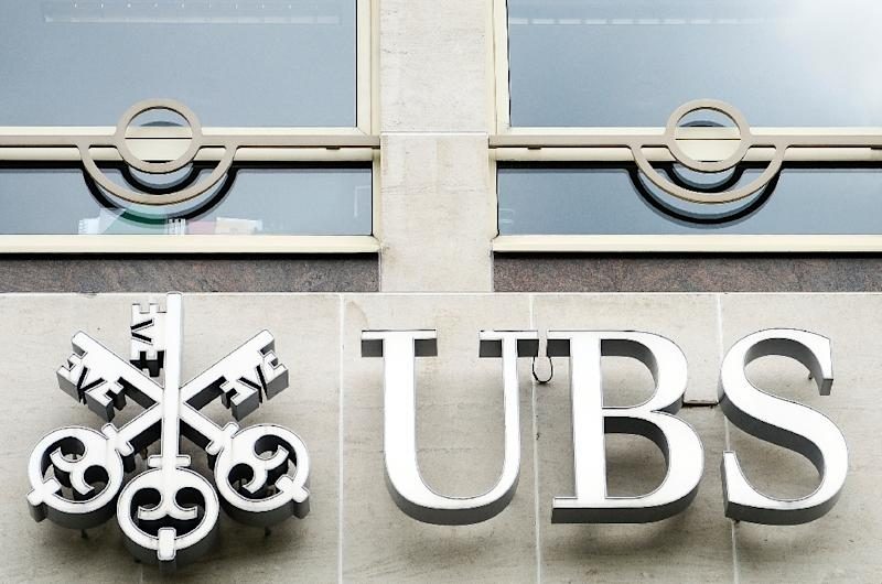 Swiss banking giant UBS said Tuesday its third quarter net profit nearly tripled, beating analyst expectationsandal (AFP Photo/Laurie Dieffembacq)
