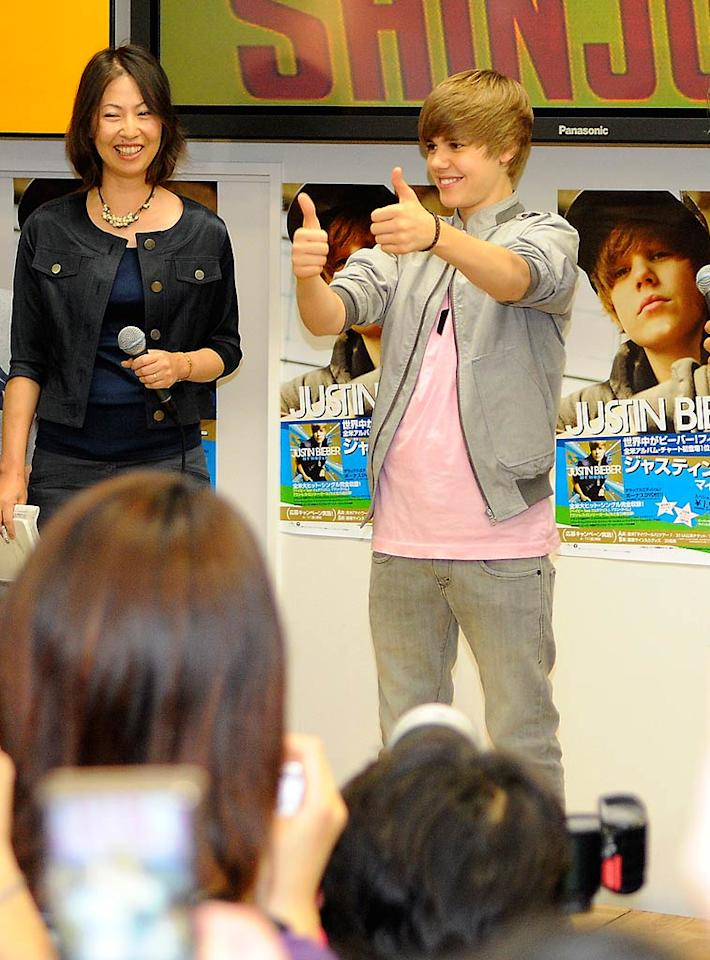 """Justin Bieber scored a nomination Tuesday for a 2010 Black Entertainment Television award. The teen sensation, spotted launching his latest album in Tokyo, was nominated for Best New Artist. The BET Awards typically honor black singers, actors, and athletes, but officials described Bieber as a cross-over artist. Scott Larson/<a href=""""http://www.splashnewsonline.com"""" target=""""new"""">Splash News</a> - May 18, 2010"""