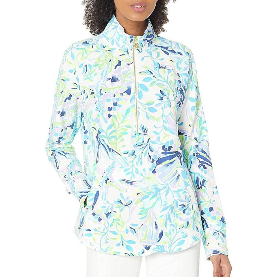 """<p><strong>Lilly Pulitzer</strong></p><p>amazon.com</p><p><strong>$98.00</strong></p><p><a href=""""https://www.amazon.com/dp/B08WL2DNJF?tag=syn-yahoo-20&ascsubtag=%5Bartid%7C2141.g.36320853%5Bsrc%7Cyahoo-us"""" rel=""""nofollow noopener"""" target=""""_blank"""" data-ylk=""""slk:Shop Now"""" class=""""link rapid-noclick-resp"""">Shop Now</a></p><p>If you're not too keen on slathering on sunscreen for chillier days, this Lilly Pulitzer pullover is a great option, covering the neck, décolletage, and even hands with <strong>UPF 50 protection.</strong></p>"""