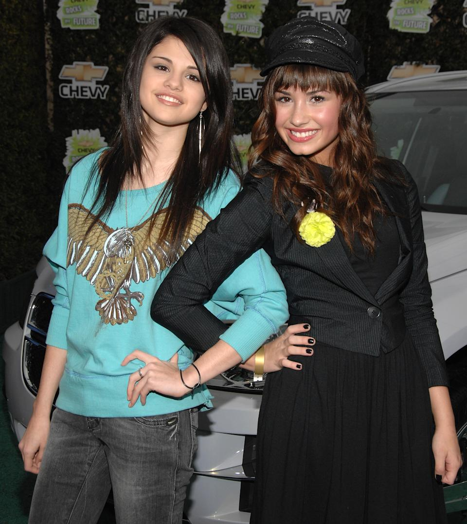 """BURBANK, CA -FEBRUARY 19: Actresses Selena Gomez and Demi Lovato arrive at """"Chevy Rocks the Future"""" held at the Walt Disney Studios on February19, 2008 in Burbank, California. (Photo by: Jean-Paul Aussenard/Wireimage)"""