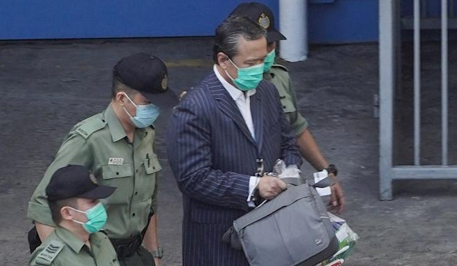 Barry Cheung being escorted to a prison van on Thursday. Photo: Handout